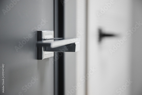 Obraz Metal doors knob handle on modern interior - fototapety do salonu