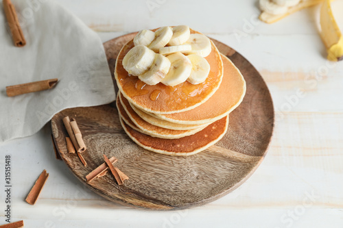 Obraz Plate with stack of tasty pancakes on table - fototapety do salonu