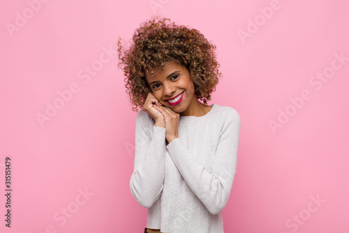 Fototapeta  young african american woman feeling in love and looking cute, adorable and happ