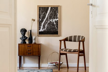 Modern Composition Of Living Room Interior With Brown Mock Up Poster Frame, Design Retro Commode, Vintage Chair, Flowers In Vase And Elegant Accessories. Template. Stylish Home Staging. Japandi.
