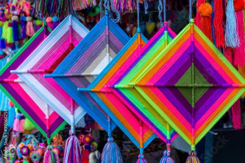 Photo Mandala God Eye Multicolored Mexican Crafts in Sayulita Mexico.
