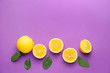 canvas print picture - Ripe lemons on color background