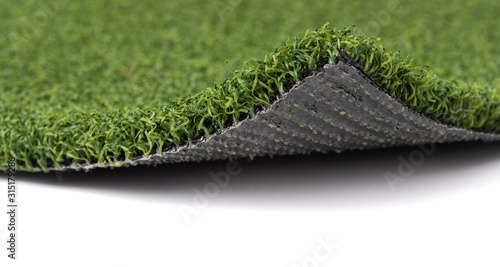 Flipped Up Section of Artificial Turf Grass On White Background Wallpaper Mural