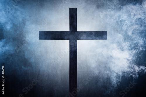 Leinwand Poster holy cross on a foggy night