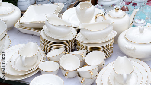 Wroclaw, Poland - 01.12.2019: huge white porcelain set on the Flea Market, swap meet in Wroclaw, Poland.