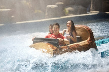 Wet Friends Laughing On Water Log Amusement Park Ride