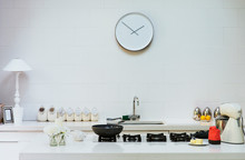 Modern Clock On Wall In Kitchen