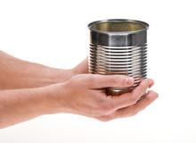 Hand Holding Empty Tin Can Iso...