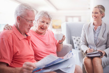 Financial Advisor Discussing Paperwork With Senior Couple