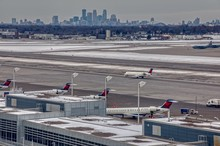 Planes At MSP International Airport With The Minneapolis Skyline