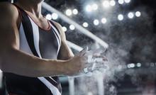 Male Gymnast Rubbing Chalk Pow...