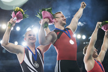 Enthusiastic Gymnasts Cheering Celebrating Victory On Winners Podium