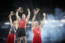 Male Gymnasts Celebrating Vict...