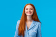 Cheerful girl enjoys life, feelings happy and upbeat, looking mirror at night as finish hygiene procedures, brushed teeth smiling joyfully toothy, standing nightwear over blue background