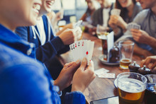 Woman Holding Aces Four Of A Kind, Playing Poker Drinking Beer Friends At Table In Bar