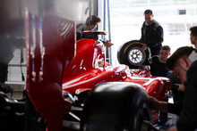 Pit Crew Working On Formula On...