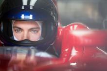 Close Up Focused Formula One Race Car Driver In Helmet Looking Away