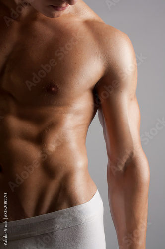 Fotomural  fit man's abs