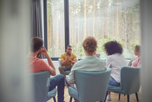 Man Talking In Group Therapy S...