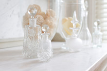 Crystal Perfume Bottles On Whi...