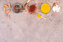 Mix Of Spices, Curcuma, Garlic, Pepper Corns And Chilli On A Brown Textured Background, Empty Copy Space