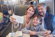 Happy Family Taking Selfie Wit...