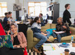 Creative business people meeting working in casual, open plan office