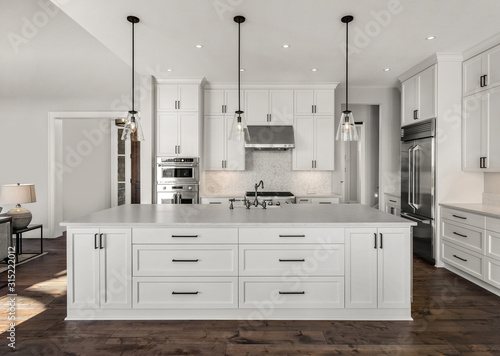 Fotomural Beautiful kitchen in new luxury home with stainless steel appliances, pendant li