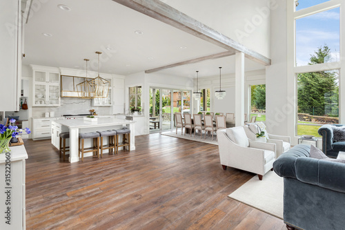Fotografie, Obraz Kitchen and living room in stunning new luxury home with open concept floor plan