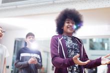 Smiling Teenage Boy Talking, Gesturing In Dance Class Studio
