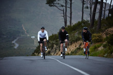 Male Cyclists Cycling On Road
