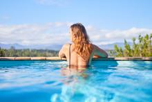 Serene Woman In Sunny Swimming...