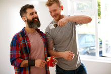 Happy Male Gay Couple Painting