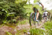 Man Mountain Biking, Splashing...