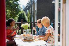 Young Women Friends Eating Bru...