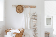 Driftwood And Aprons Hanging From Beach House Coat Rack