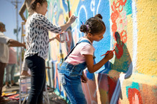 Girl Volunteer Painting Vibran...