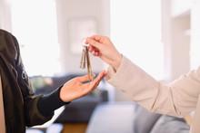 Real Estate Agent Giving Keys ...
