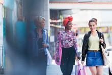 Young Women Friends Walking Wi...