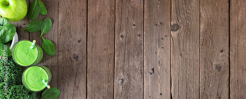 Fototapeta Banner with healthy green smoothie side border. Top view over a rustic wood background with copy space. obraz