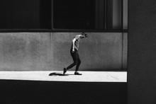 Shadow Following Man Walking On Sunny Pavement