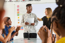 High School Students Clapping For Classmate In Debate Class