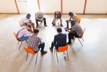 Men Praying In Circle In Praye...