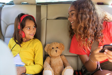 Sisters And Teddy Bear Riding ...