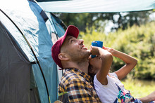 Curious Father Daughter Bird Watching Binoculars At Sunny Campsite