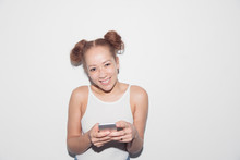 Portrait Smiling, Confident Young Woman Texting With Smart Phone