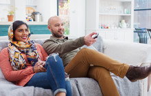 Couple Watching TV On Living R...