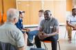 men talking in community center