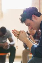 Serene Man Praying With Rosary...