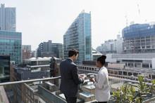 Business People On Sunny, Urban Balcony, Shoreditch, London